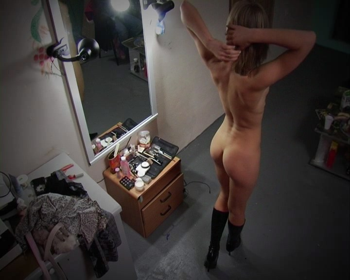 Dishy babe filmed when dressing