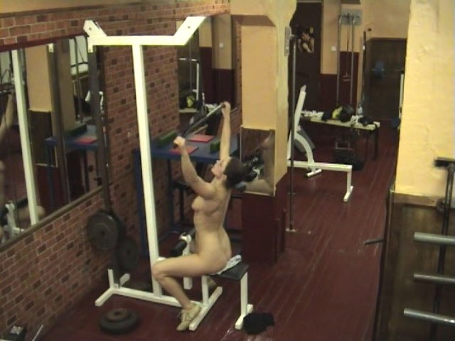 Sexy brunette stripping in discase gym