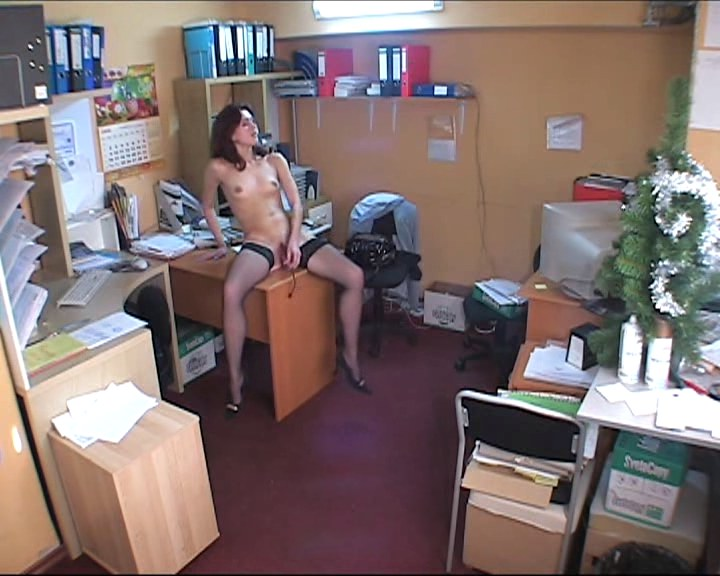 Sweet brunette playing shrunken pussy in office
