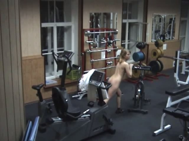 nice looking doll exercising naked in the gym