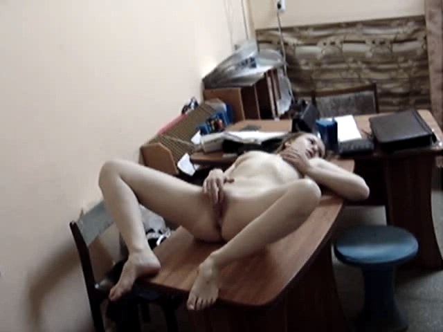 Lusty chick rubbing cunt on her office habitable