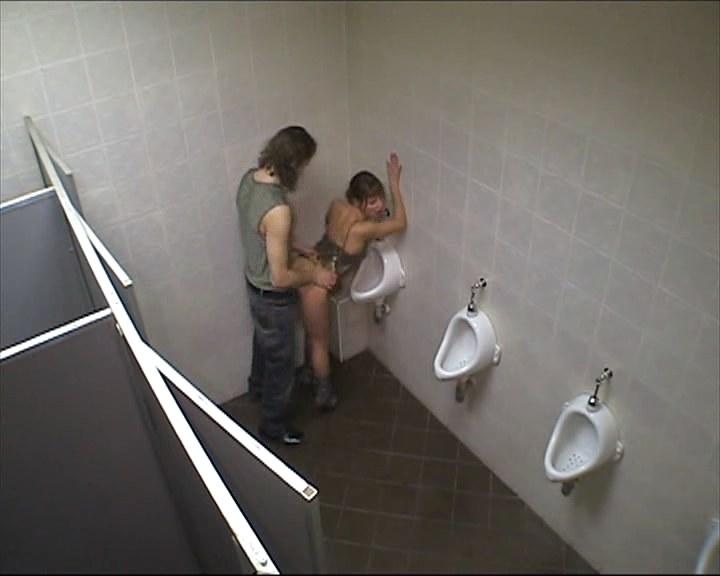 Horny babe fucked in the men's room!
